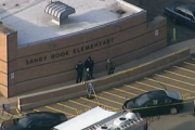 Police outside the school shortly after arriving on scene of the shooting December 14. Image: Voice of America.